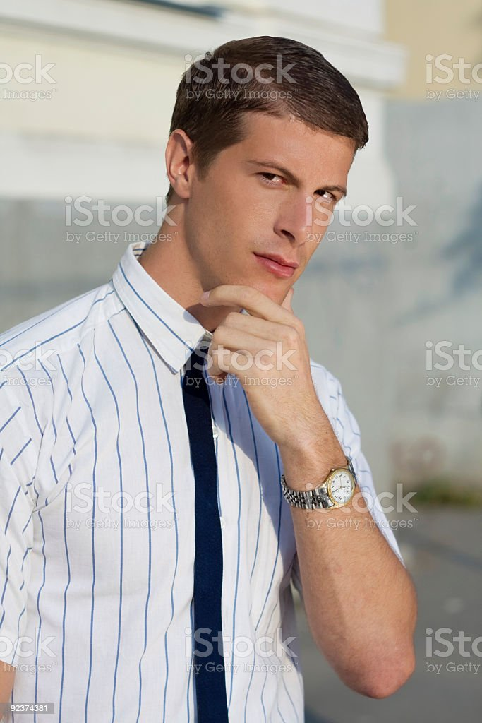 Handsome young businessman in retro clothes posing outdoor royalty-free stock photo