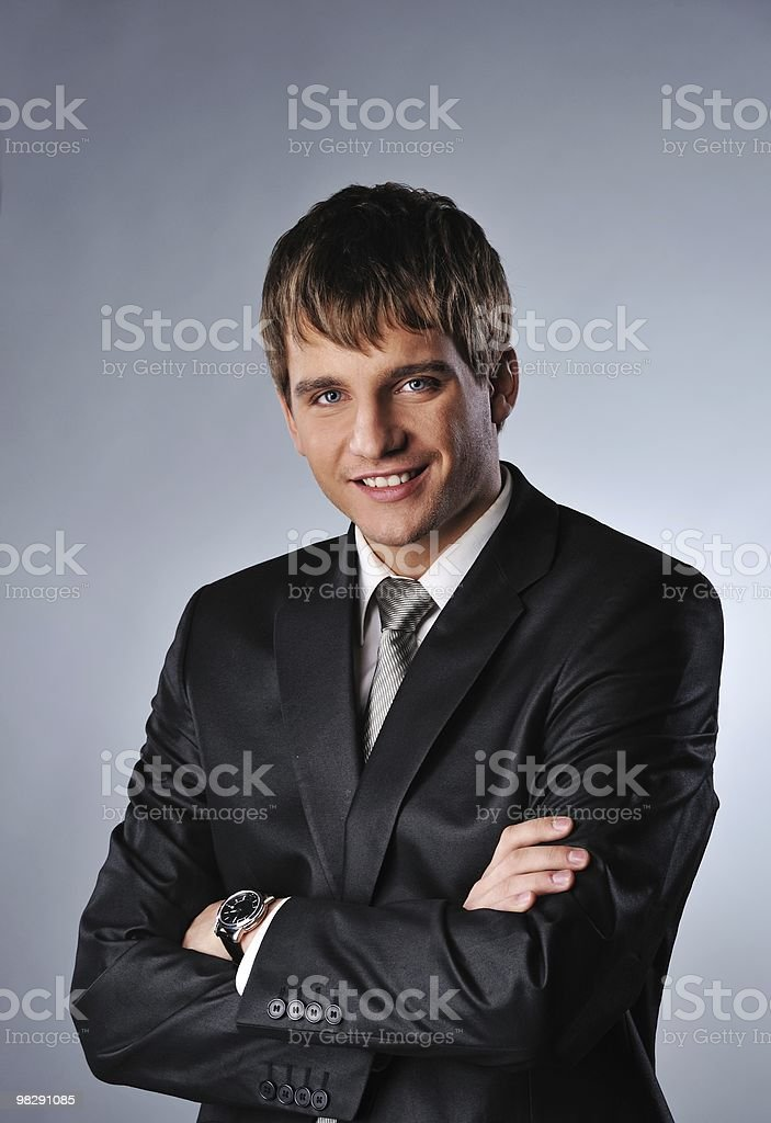 Handsome young businessman isolated on grey background royalty-free stock photo