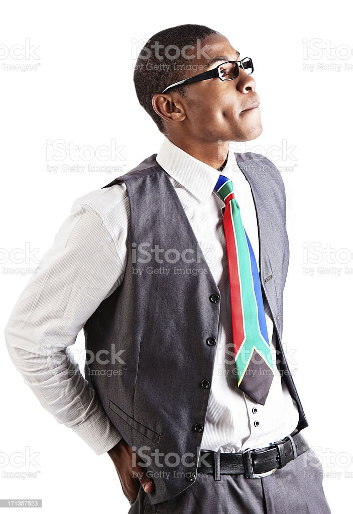 Handsome young businessman looks to side, concerned royalty-free stock photo