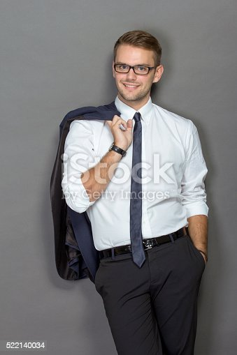 498403166 istock photo Handsome young businessman wearing glasses and smiling 522140034