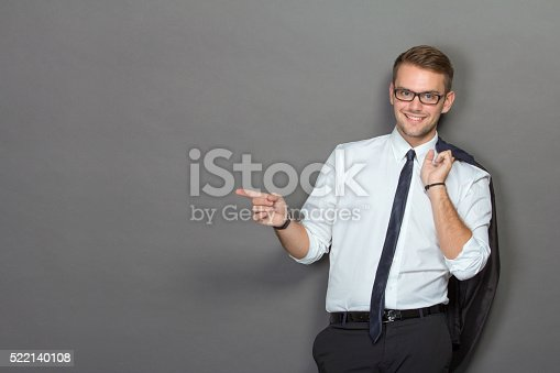 498403166 istock photo Handsome young businessman wearing glasses and smiling 522140108