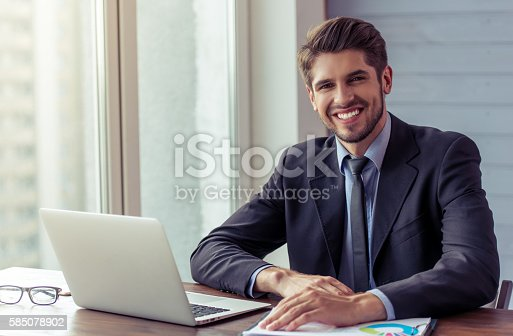 istock Handsome young businessman working 585078902