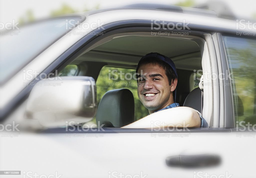 Handsome Young College Student Driving Car royalty-free stock photo