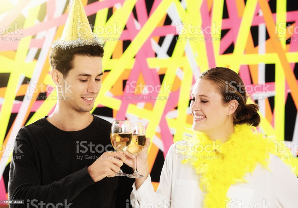 Handsome young couple at party toast each other, smiling royalty-free stock photo