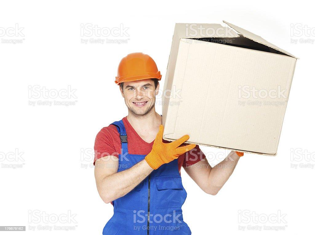 Atractivo joven hombre con cajas de papel de entrega foto de stock libre de derechos