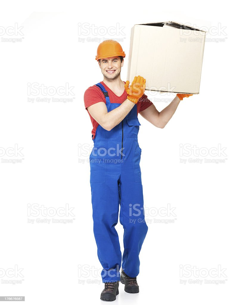 handsome young delivery man with paper boxes royalty-free stock photo