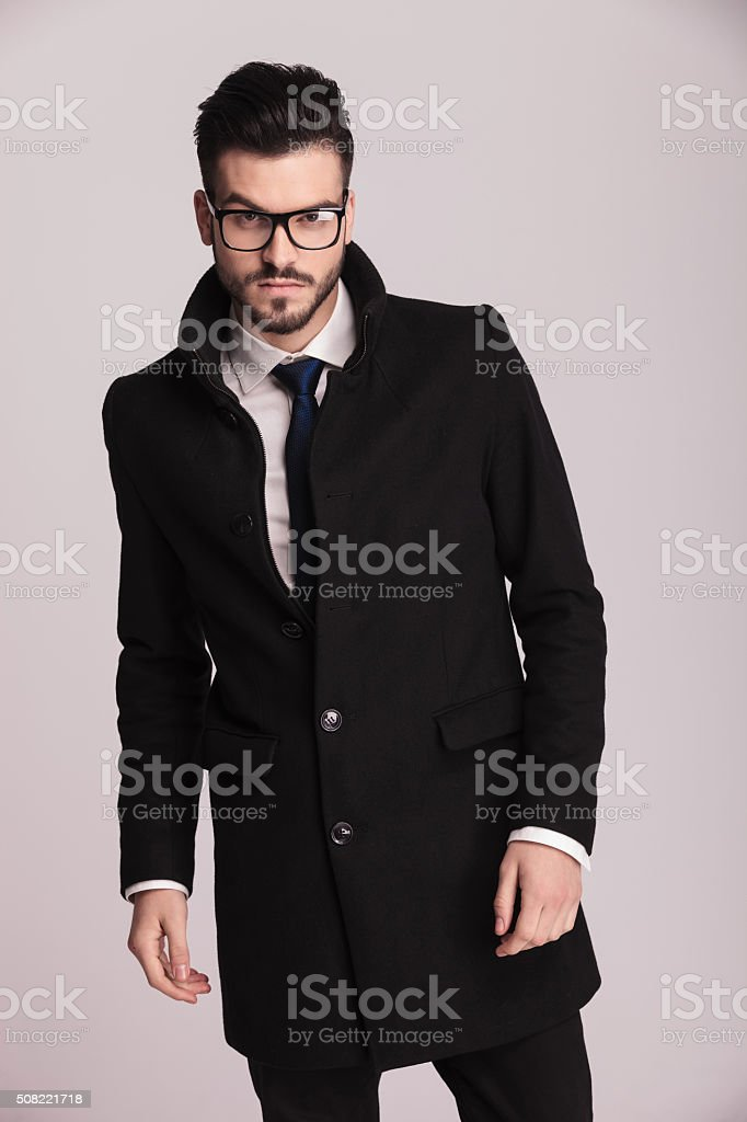 Handsome young elegant business man posing stock photo
