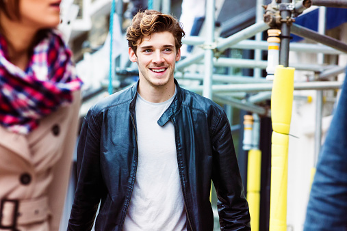 Handsome young English male commuter smiling