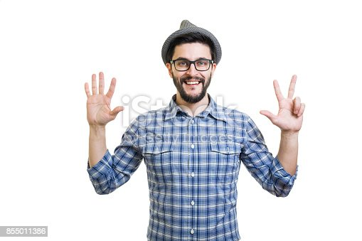 636829300 istock photo Handsome young guy in eyeglasses and hat showing eight on hand 855011386