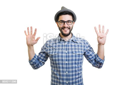 636829300 istock photo Handsome young guy in eyeglasses and hat showing nine on hand 855011396