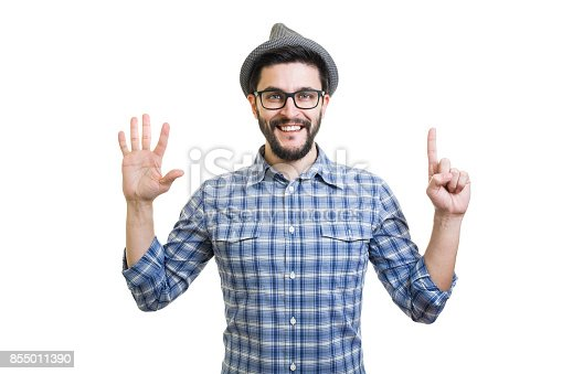 636829300 istock photo Handsome young guy in eyeglasses and hat showing six on hand 855011390