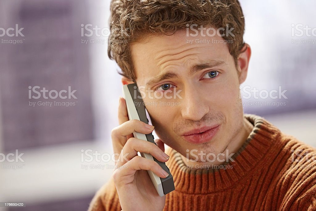 Handsome young guy making a phone call royalty-free stock photo