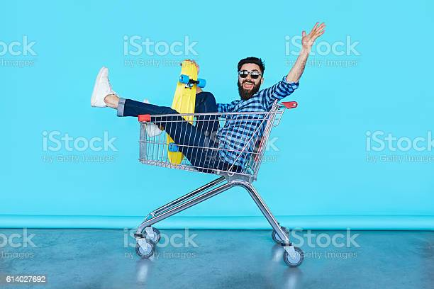 Handsome young hipster man sitting in the shopping cart picture id614027692?b=1&k=6&m=614027692&s=612x612&h=ce  0mz wfkkencelou0auvhzy9rqosdqk0rftxuiyg=