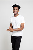 istock Handsome young in causals laughing on white background 1040480906