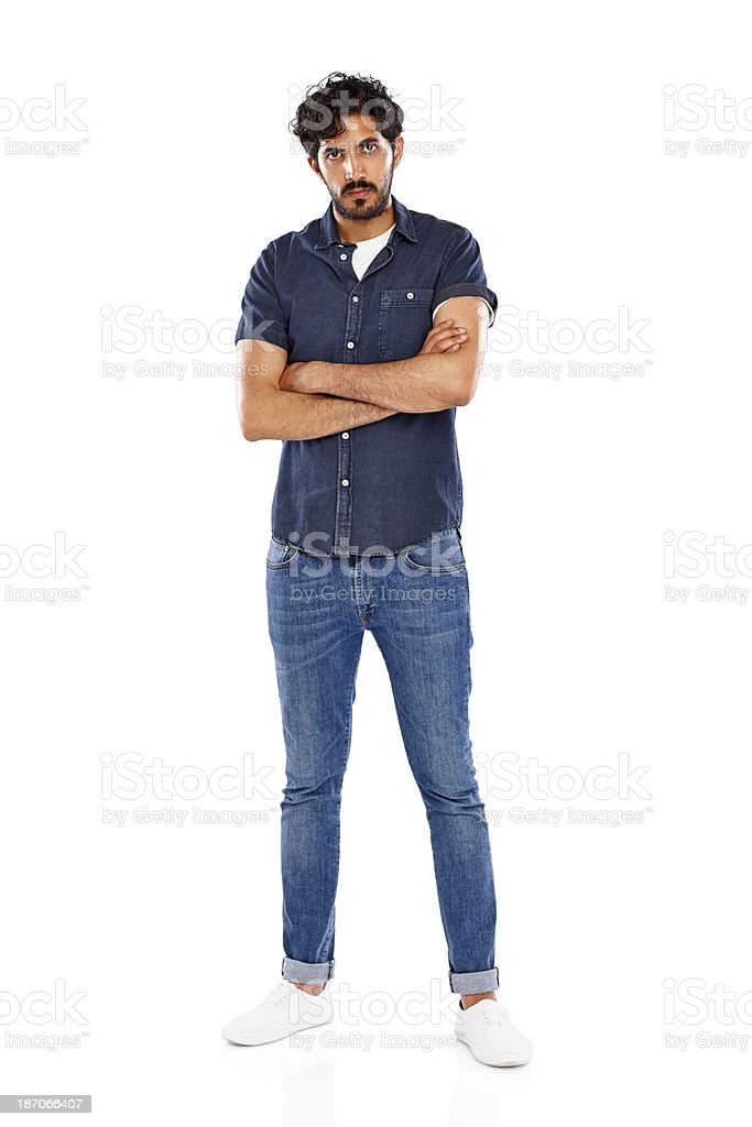 Handsome young Indian man standing on white royalty-free stock photo