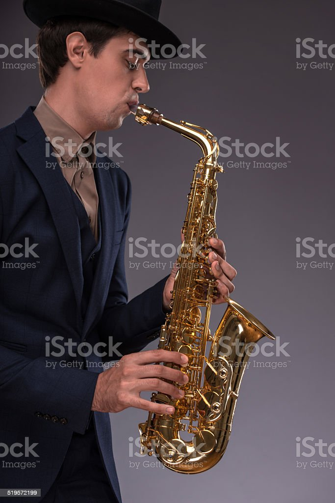 Handsome young jazz man stock photo