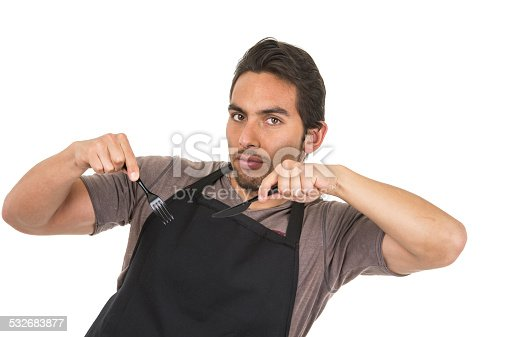 istock handsome young male chef wearing black apron 532683877