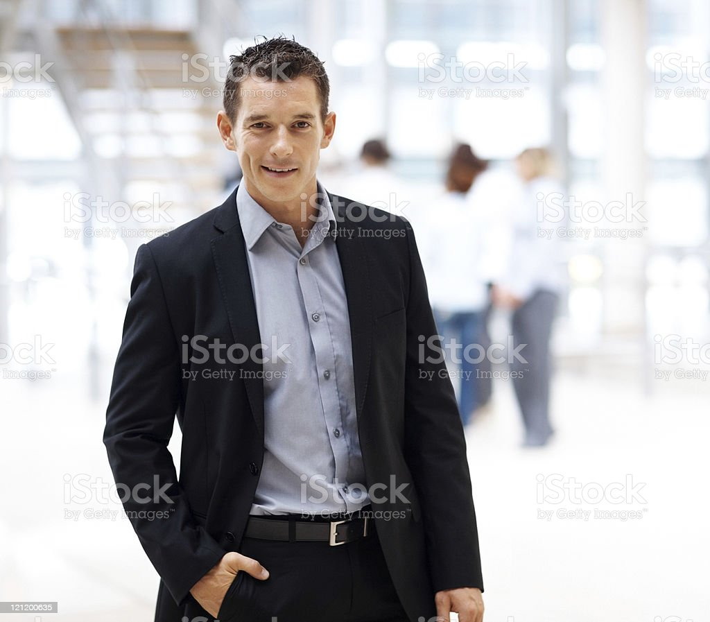 Handsome young male entrepreneur looking confidently royalty-free stock photo