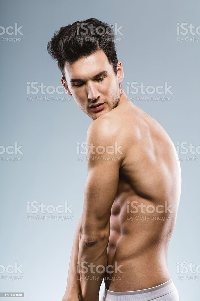 Handsome young male fashion model posing royalty-free stock photo