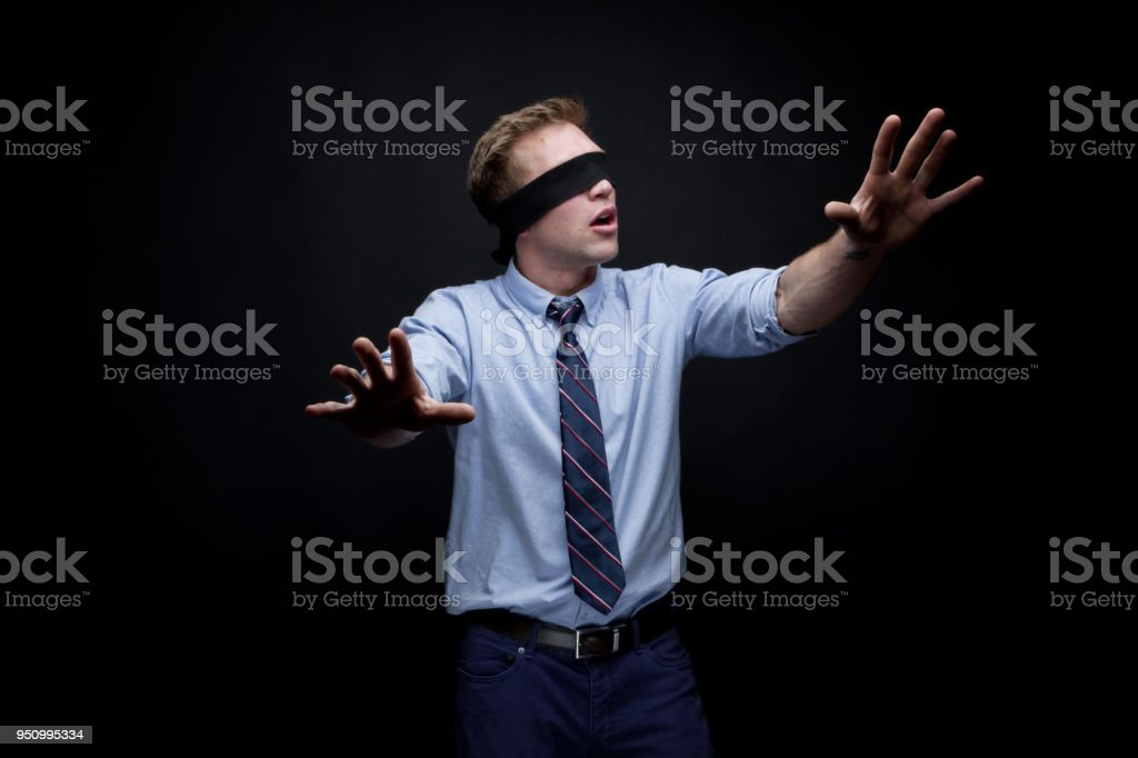 Handsome young male is searching stock photo