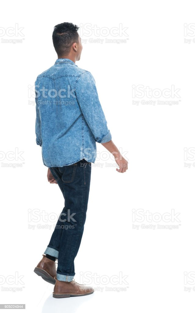 Handsome young male walking stock photo