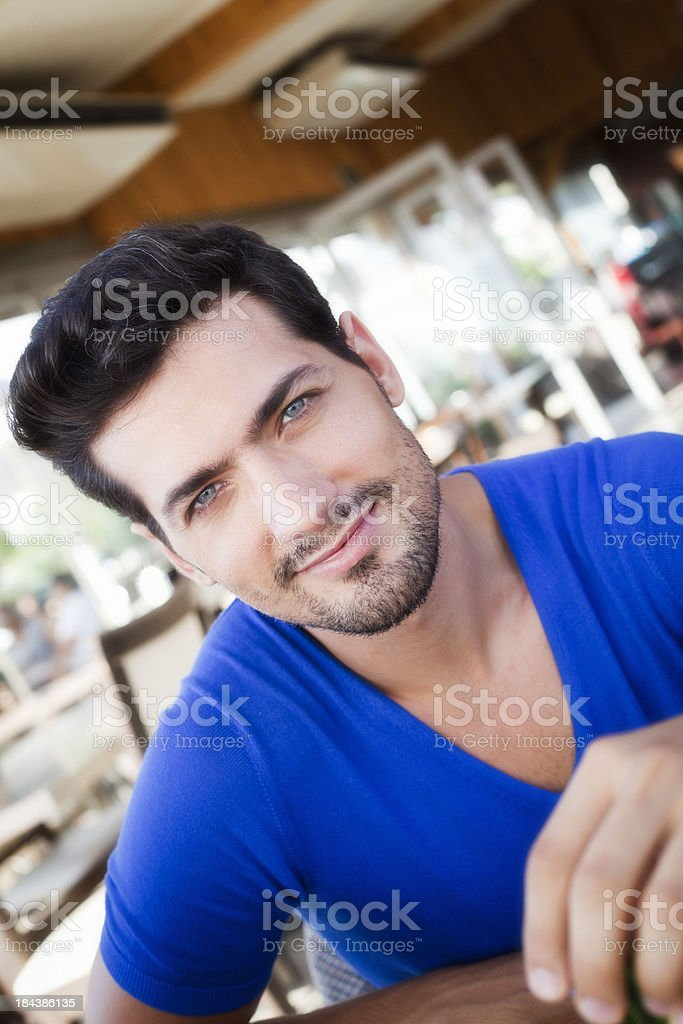 Handsome young man at Cafe royalty-free stock photo