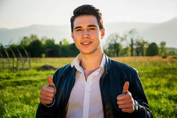 Cessons de nous plaindre ! Remercions plutôt Dieu pour Ses bienfaits ! - Page 2 Handsome-young-man-at-countryside-in-front-of-field-or-picture-id481962718?k=6&m=481962718&s=612x612&w=0&h=8-pGDTRL1rTJ6OUDsDxBKNZXEGXJPyb_cDeCVFof56k=