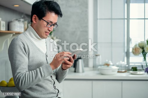 istock Handsome young man checking news 1132021832