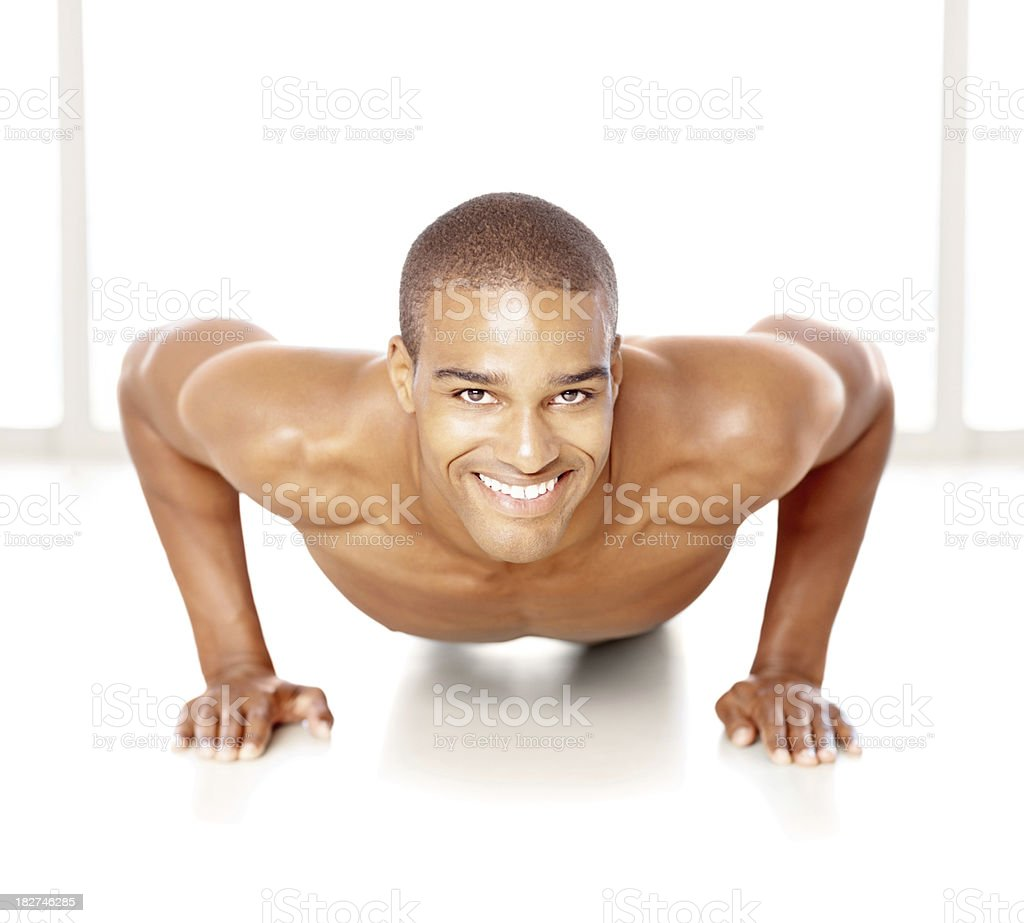 Handsome young man doing push ups against white royalty-free stock photo