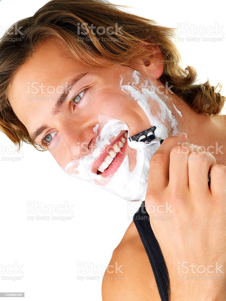 Handsome young man having his morning shave royalty-free stock photo