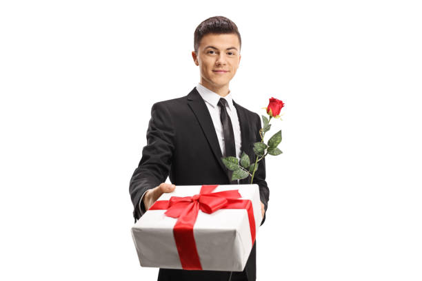 Handsome young man in a suit giving a present and a red rose picture id1127568558?b=1&k=6&m=1127568558&s=612x612&w=0&h=n3e4cl6kayvfxbjz jx7ou5ftdbyrgudwv5cgoi9uni=