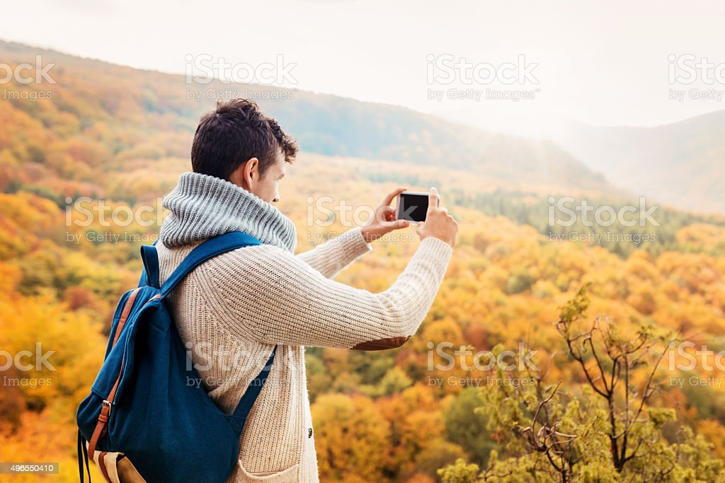 Handsome young man in autumn nature
