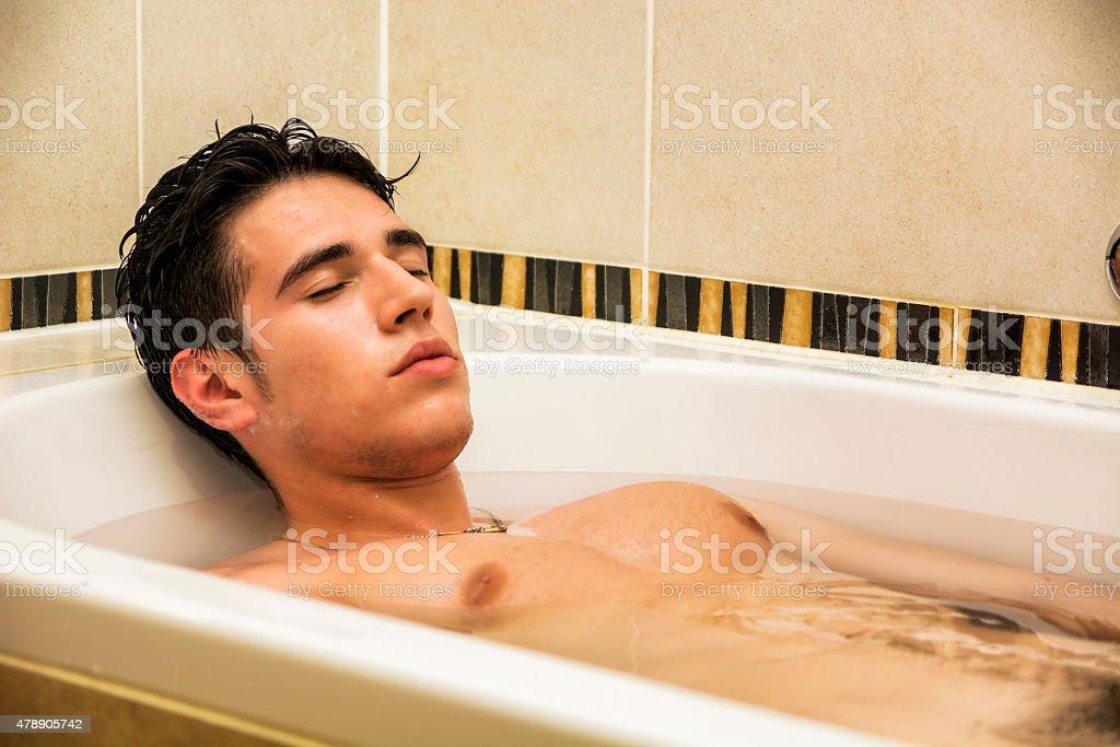 Guy soaking in bath — photo 7