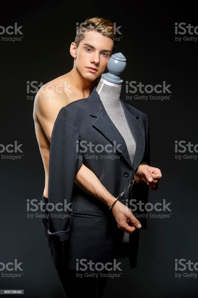 handsome young man in black jacket stock photo