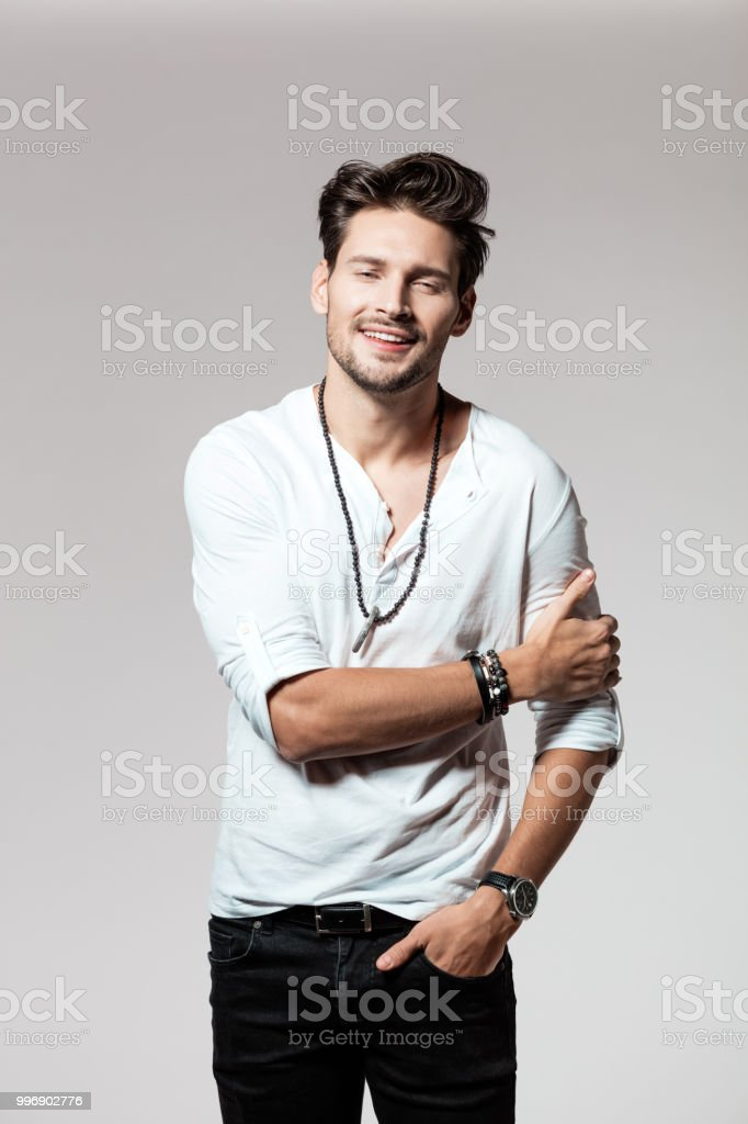 Handsome young man in casual attire Portrait of handsome young man in casual attire standing over grey background 25-29 Years Stock Photo