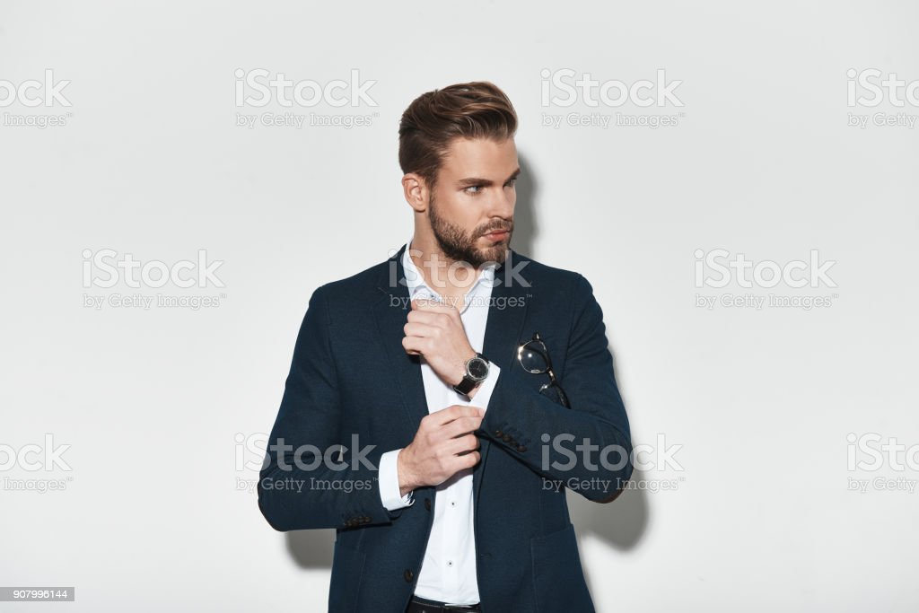 Handsome young man in full suit stock photo