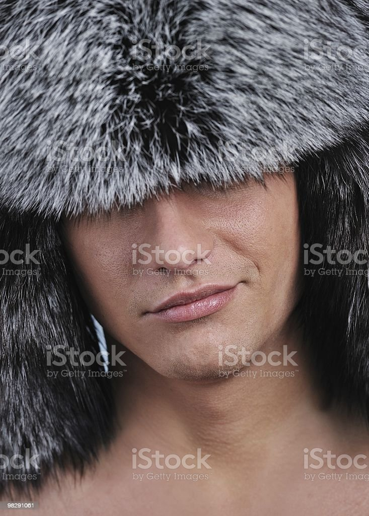 handsome young man in fur hat royalty-free stock photo