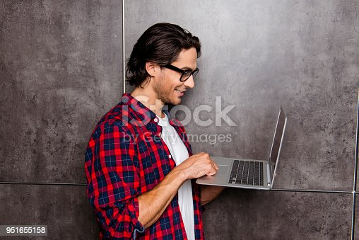 947303582 istock photo handsome young man in glasses using laptop, he chatting with friends 951655158