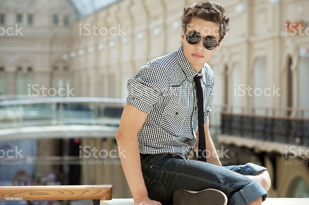 Handsome young man in the business center. stock photo