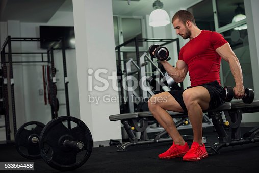 istock Handsome young man in the gym 533554488