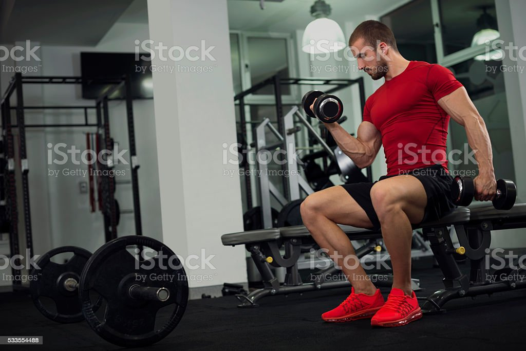 Handsome young man in the gym stock photo