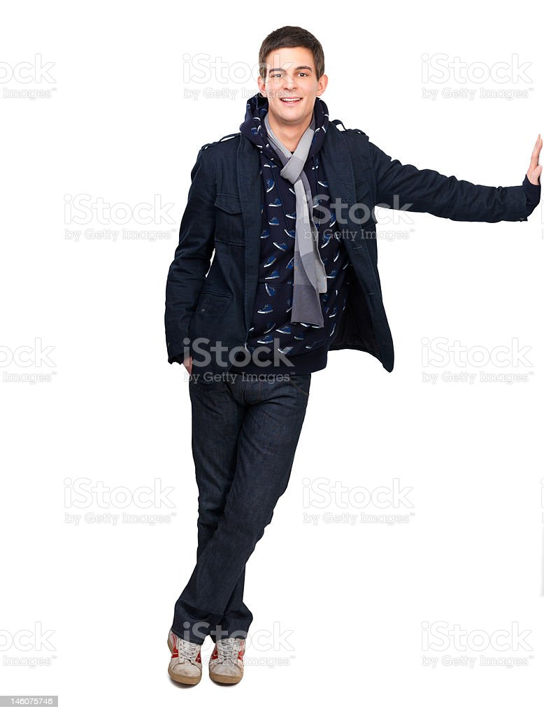 Handsome young man leaning against wall on white background stock photo