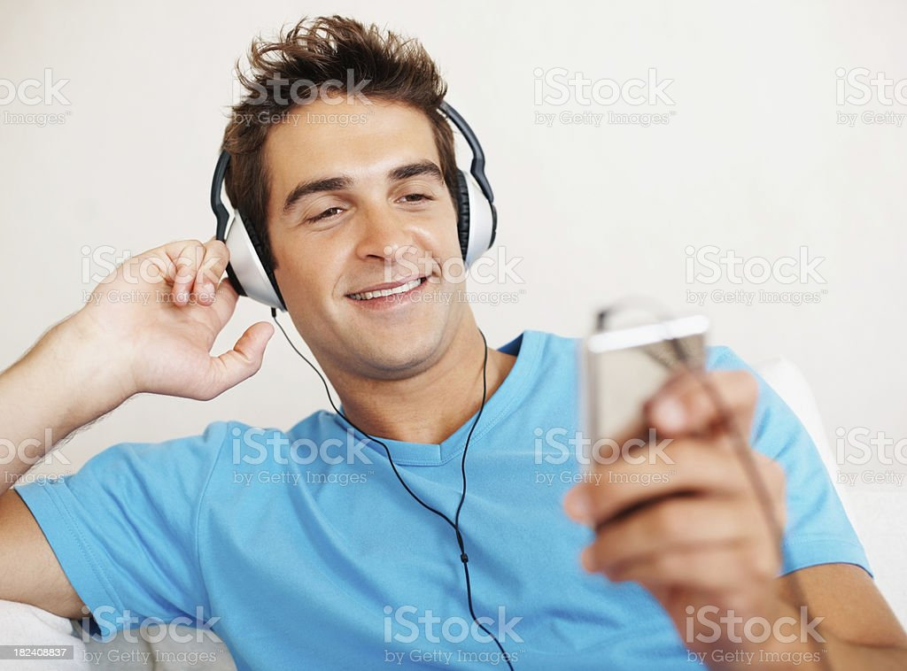 Handsome young man listening to music royalty-free stock photo