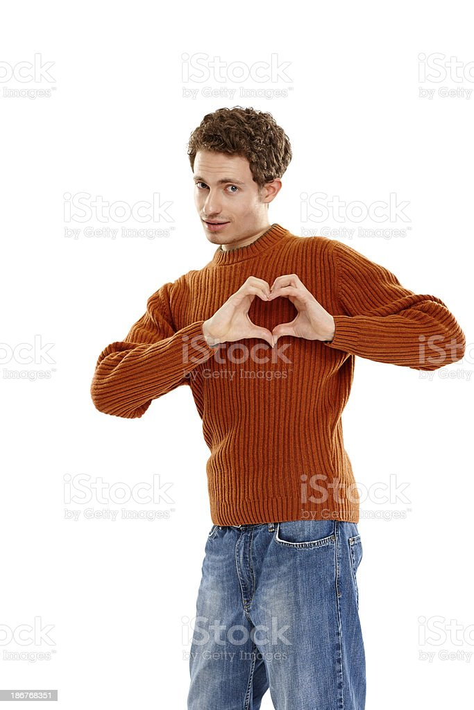 Handsome young man making heart royalty-free stock photo