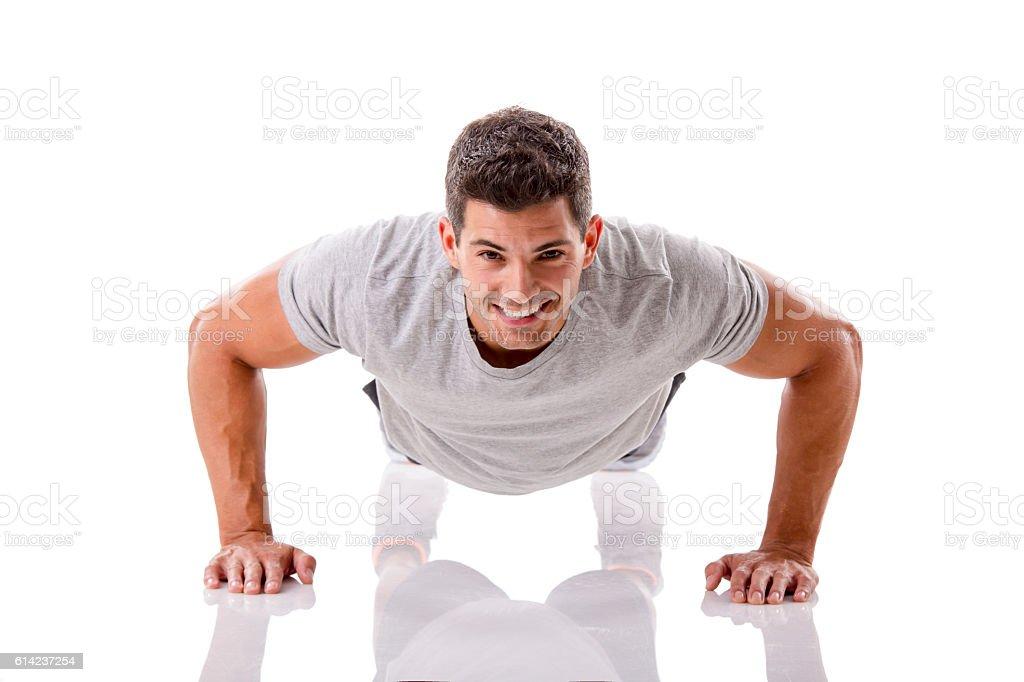 Handsome young man making pushups – Foto