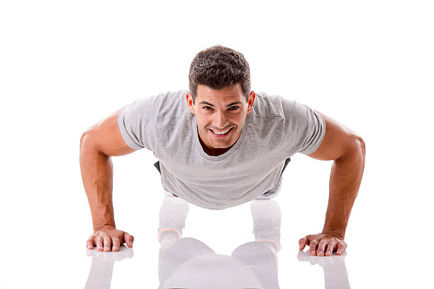handsome young man making pushups - push up stock photos and pictures