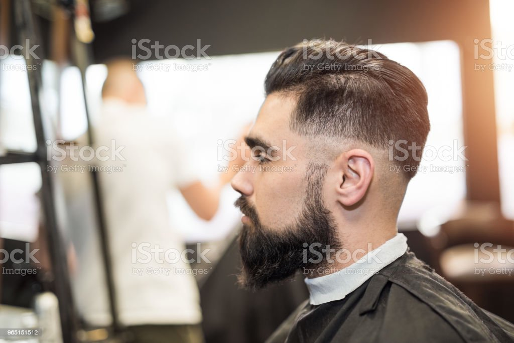 Handsome young man on the visit to hair dresser. royalty-free stock photo