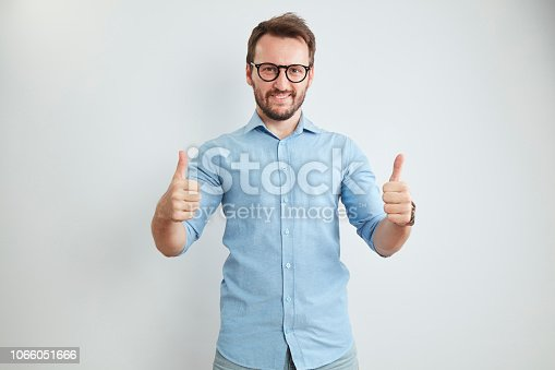 636829300 istock photo Handsome Young Man on White Background 1066051666