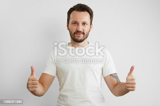 636829300 istock photo Handsome Young Man on White Background 1066051990
