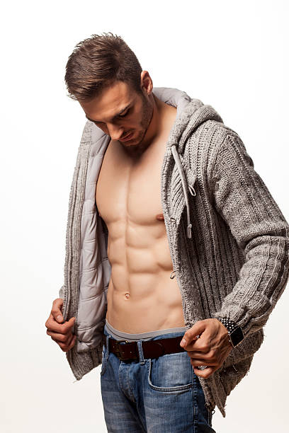Best Undressing Men Getting Dressed Naked Stock Photos